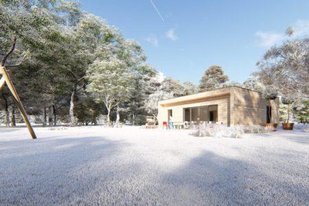 Maison en bois écologique sous la neige