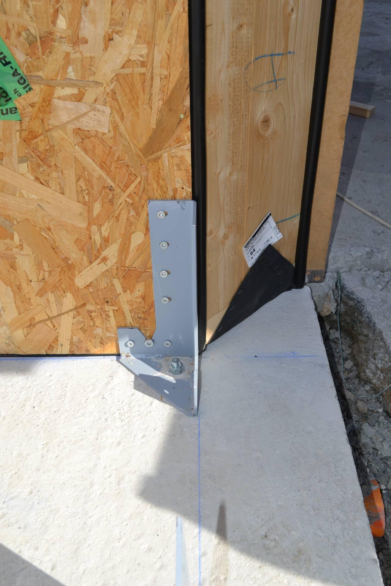 Fixation ossature bois dalle beton