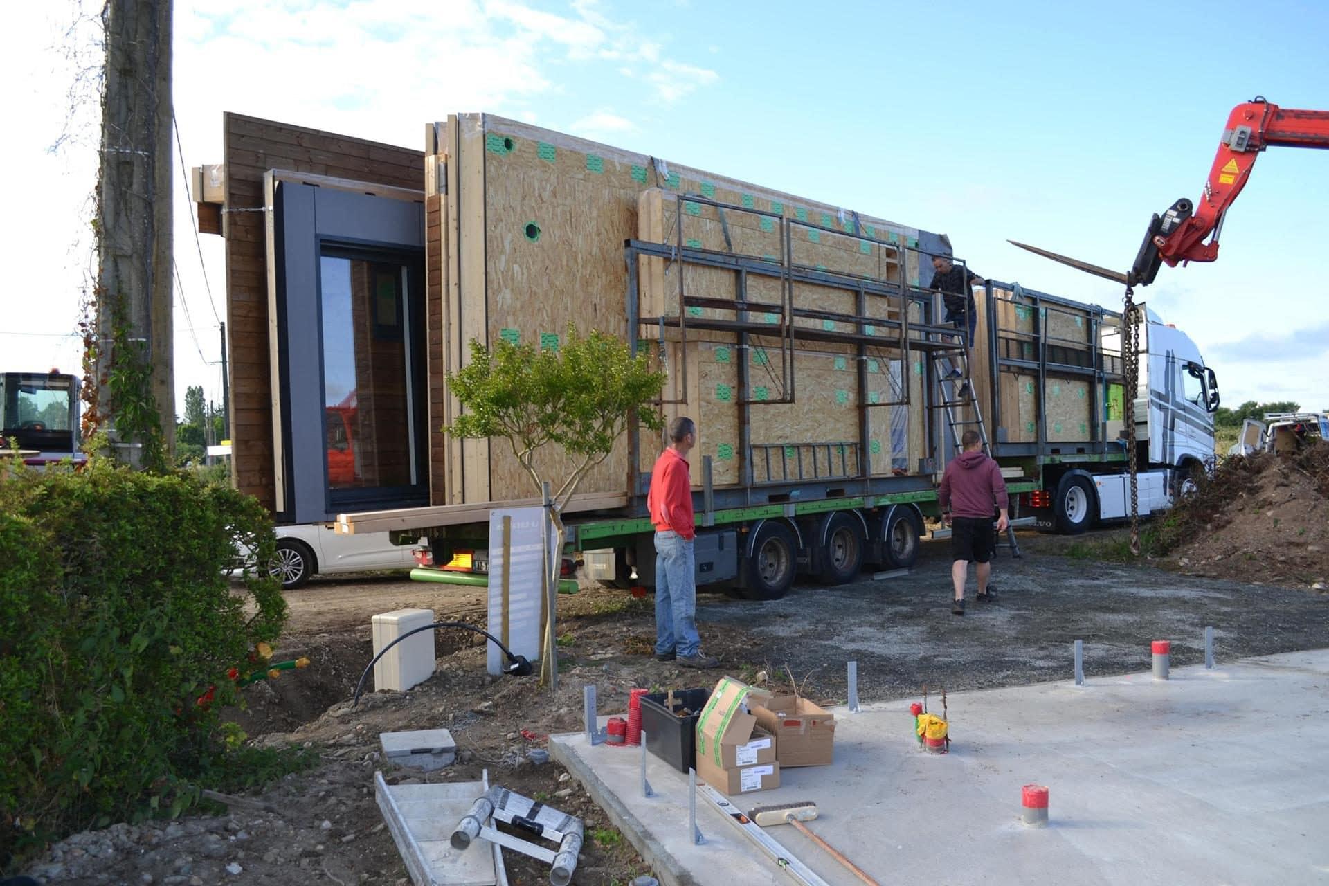 livraison maison bois par camion